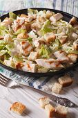 pic of caesar salad  - Delicious Caesar salad with grilled chicken breast close - JPG