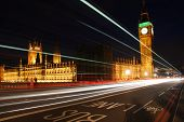stock photo of big-ben  - Big Ben at night in London Uk with cars driving and light trail - JPG