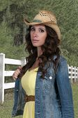 pic of country girl  - Beautiful young country girl woman wearing a stylish cowboy hat - JPG