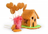 foto of gingerbread house  - Gingerbread house and gingerbread isolated on white background - JPG