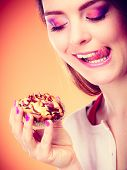 picture of licking  - Bakery sweet food and people concept - JPG