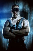 pic of minerals  - Portrait of a strong muscular man coal miner standing over dark grunge background - JPG