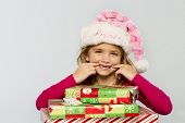 picture of missing teeth  - A little girl in a studio environment with presents missing her two front teeth - JPG