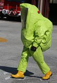 pic of asbestos  - person with yellow protective suit to work in presence of asbestos - JPG