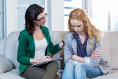 stock photo of psychologist  - Psychologist comforting a depressed patient in the office - JPG