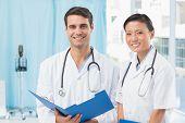foto of medical office  - male and female doctors at medical office - JPG