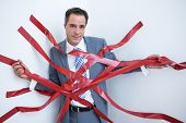 picture of trap  - Businessman trapped by red tape on white background - JPG