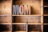 pic of matron  - The word MOM written in vintage wooden letterpress type in a wooden type drawer - JPG