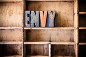 image of envy  - The word ENVY written in vintage wooden letterpress type in a wooden type drawer - JPG