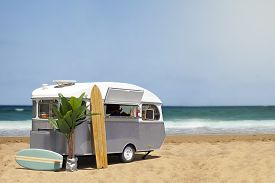 pic of food truck  - Surfing fast food truck stream line caravan on the beach template with copy space - JPG