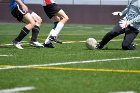 foto of sweeper  - Adult, male, soccer striker, sweeper and goalkeeper going for the ball ** Note: Soft Focus at 100%, best at smaller sizes - JPG