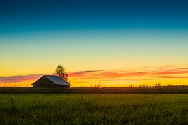 pic of barn house  - The mist rises on the fields in the cold nights of the spring in the rural Finland - JPG