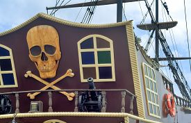 image of pirates  - The photo shows a fragment of the stern of a yacht with the image of a pirate symbols - JPG