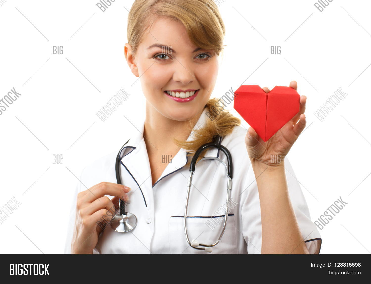 White apron health - Smiling Woman Doctor Cardiologist In White Apron With Stethoscope Holding Red Heart Of Paper Healthcare And