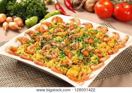 Spanish dish paella with seafood shrimps squid rice saffron traditional tasty dinner