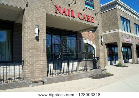PLAINFIELD, ILLINOIS / UNITED STATES - SEPTEMBER 20, 2015: One may have one's nails trimmed at a nail salon in the Town Square on Lockport Street in Plainfield.