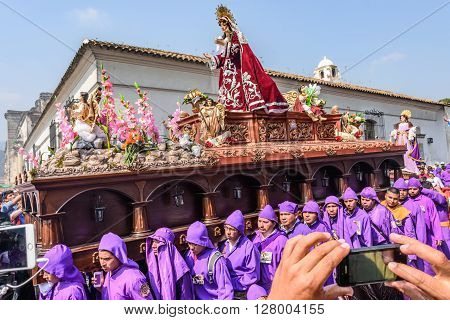 Antigua Guatemala - March 24 2016: Local men carry float with Virgin Mary in Holy Thursday procession in colonial town with most famous Holy Week celebrations in Latin America.