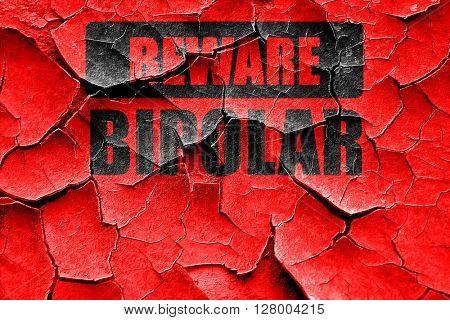 Grunge cracked Bipolar sign background