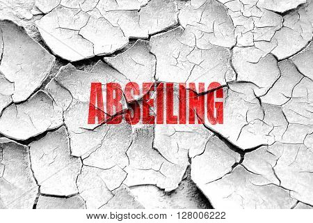 Grunge cracked abseiling sign background