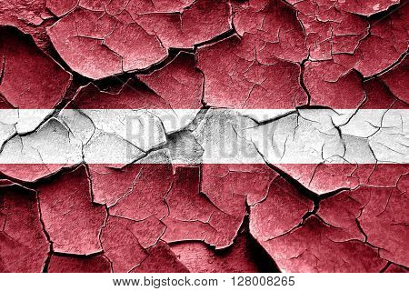 Grunge Latvia flag with some cracks and vintage look