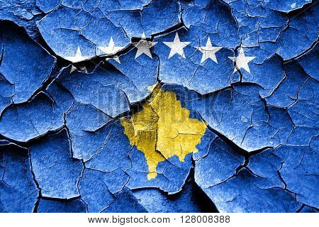 Grunge Kosovo flag with some cracks and vintage look
