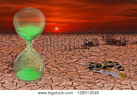 Global warming conceptual composite image with hourglass symbolizing a short time lapse needed for a drastic change in climate of our planet.