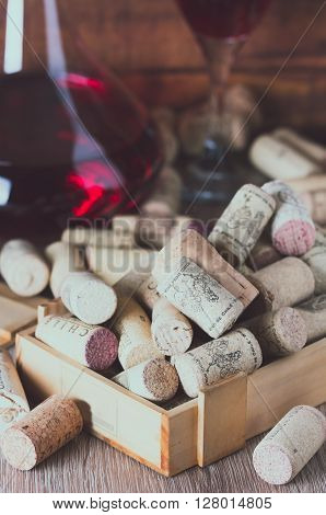 Background with glass of wine, decanter and wine corks. Wine concept