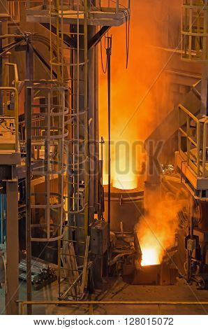 Photograph shows the active stage melting of steel electrically on modern technology