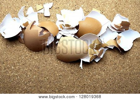 Egg shells on cork message board/bulletin board. Space for texts.