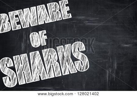 Chalkboard writing: Beware of sharks sign