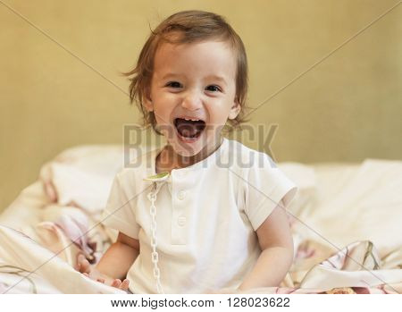 Happy small happy baby girl at home