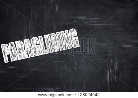 Chalkboard writing: paragliding sign background