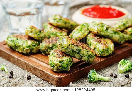 baked broccoli oat cheese sticks on a wood background