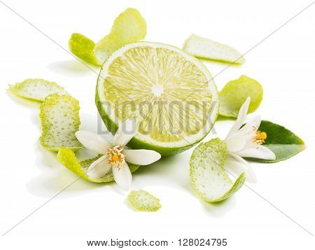 Flowers zest and lime fruit isolated on white background.