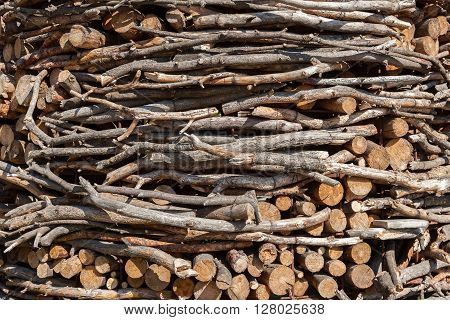 the chopped firewoods are neatly put supply of firewoods on a winter
