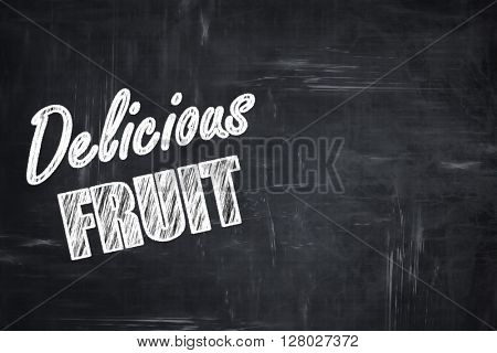 Chalkboard background with chalk letters: Delicious fruit sign