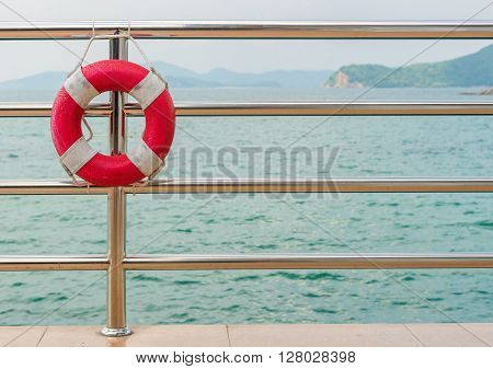Red Lifebuoy On Railing By The Sea