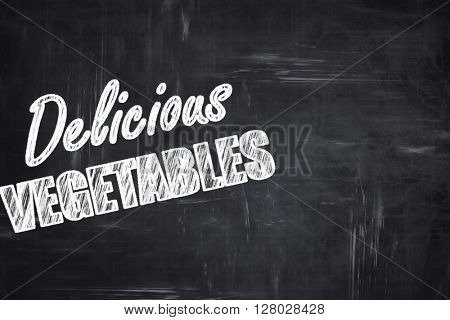 Chalkboard background with chalk letters: Delicious vegetable si