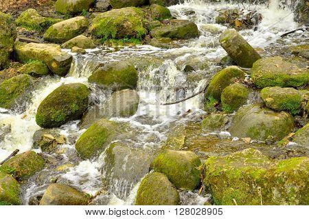 Small waterfall on Slavianka River in Pavlovsk Russia.