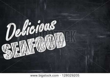 Chalkboard background with chalk letters: Delicious fish sign