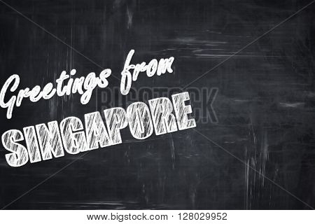 Chalkboard background with chalk letters: Greetings from singapo