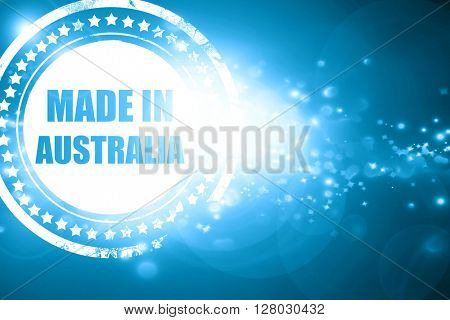 Blue stamp on a glittering background: Made in australia