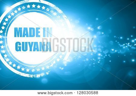 Blue stamp on a glittering background: Made in guyana