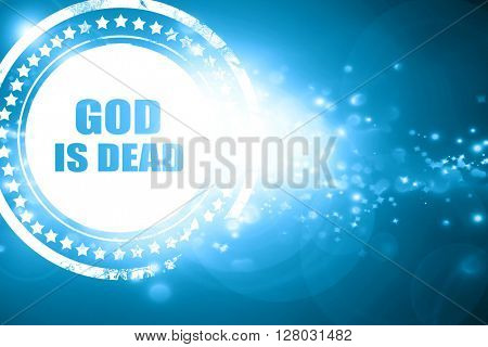 Blue stamp on a glittering background: god is dead