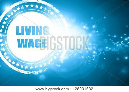 Blue stamp on a glittering background: living wage