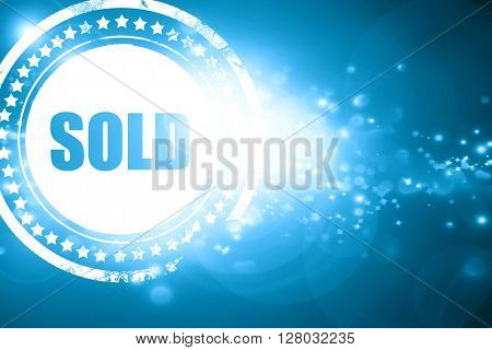Blue stamp on a glittering background: sold sign background