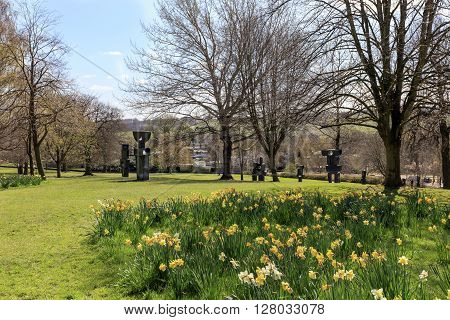 WAKEFIELD, YORKSHIRE, UK - APRIL 19, 2016: The Family of Man, a group of 9 individual bronze sculptures was one of Barbara Hepworths final works, completed in 1970 exhibited in YSP, Wakefield, on April 19, 2016.