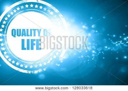 Blue stamp on a glittering background: quality of life