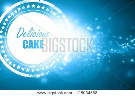Blue stamp on a glittering background: Delicious cake sign