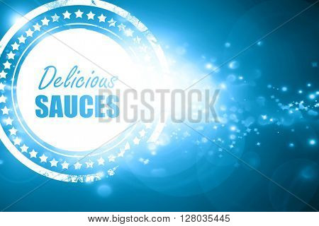 Blue stamp on a glittering background: Delicious sauces sign